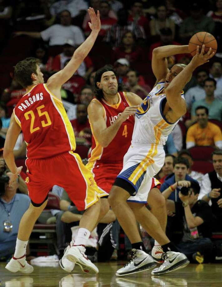 The Houston Rockets Chandler Parsons left and Luis Scola center, double-team the Golden State Warriors Richard Jefferson right, during the first quarter of NBA game action at the Toyota Center Thursday, March 22, 2012, in Houston. Photo: James Nielsen, Chronicle / © 2012 Houston Chronicle