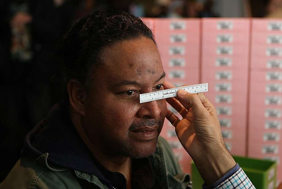 Nez Winslet from Oakland having his bridge measured for glasses at the Oakland coliseum in Oakland, Calif., on Thursday, March 22, 2012.    He says he was the first patient to arrive yesterday at 5pm but was told to come back at 9pm. Photo: Liz Hafalia, The Chronicle