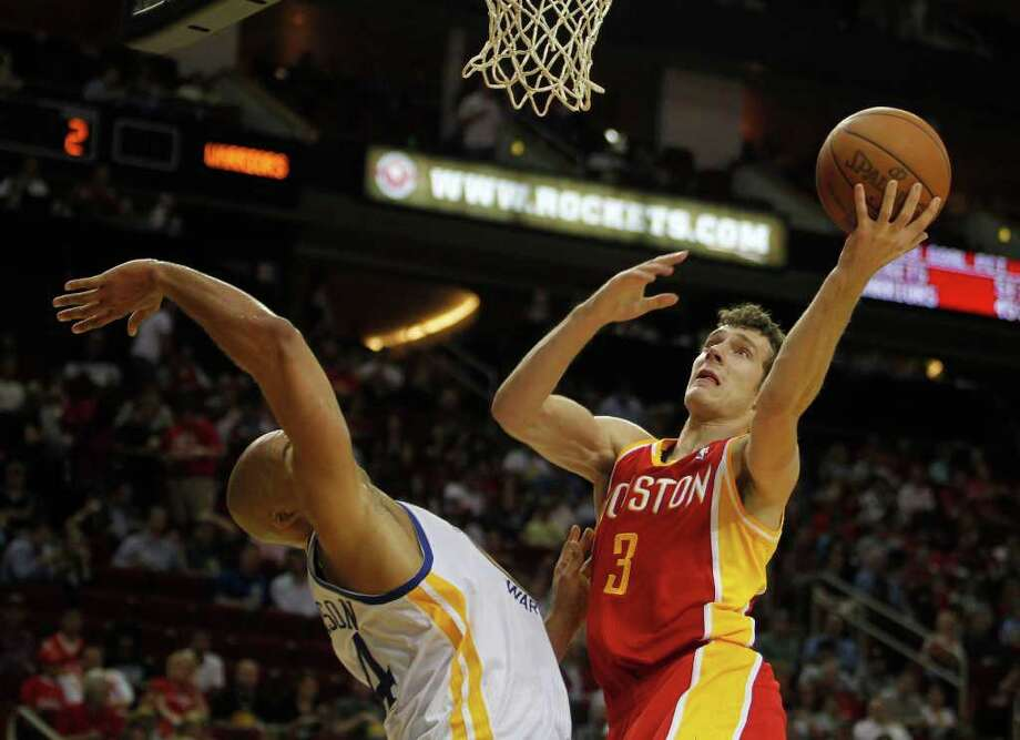 The Houston Rockets Goran Dragic right, shoots over the Golden State Warriors Richard Jefferson left, during the second quarter of NBA game action at the Toyota Center Thursday, March 22, 2012, in Houston. Photo: James Nielsen, Chronicle / © 2012 Houston Chronicle