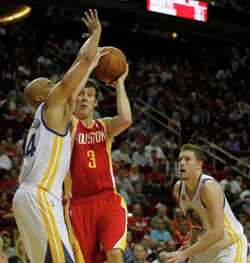 The Houston Rockets Goran Dragic center, collides with the Golden State Warriors Richard Jefferson left, as the Warriors David Lee looks on during the second quarter of NBA game action at the Toyota Center Thursday, March 22, 2012, in Houston. Photo: James Nielsen, Chronicle / © 2012 Houston Chronicle