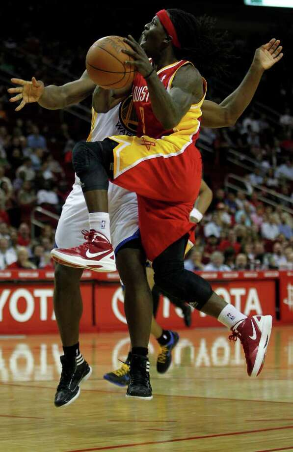 The Houston Rockets Courtney Fortson right' collides with the Golden State Warriors Charles Jenkins during the second quarter of NBA game action at the Toyota Center Thursday, March 22, 2012, in Houston. Photo: James Nielsen, Chronicle / © 2012 Houston Chronicle