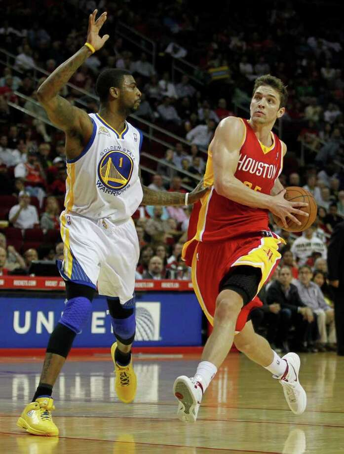 The Houston Rockets Chandler Parsons right, drives past with the Golden State Warriors Dorell Wright during the second quarter of NBA game action at the Toyota Center Thursday, March 22, 2012, in Houston. Photo: James Nielsen, Chronicle / © 2012 Houston Chronicle