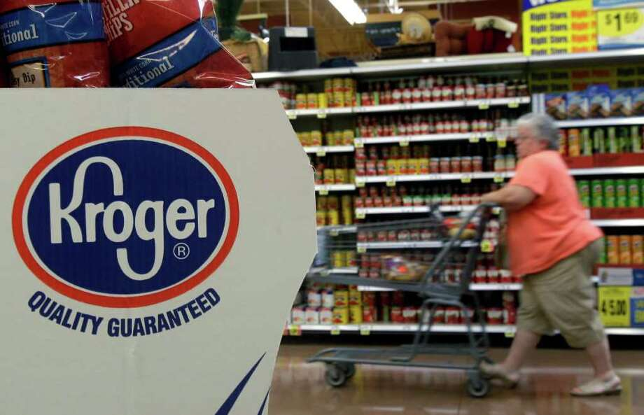 """FILE - In this Sept. 13, 2010 file photo, a shopper moves through a Kroger Co. supermarket in Newport, Ky. Supermarket chains Kroger Co. and Stop & Shop said Thursday, March 22, 2012 they will join the growing list of store chains that will no longer sell beef that includes an additive with the unappetizing moniker """"pink slime."""" (AP Photo/Al Behrman, File) Photo: Al Behrman"""