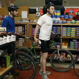 Square 2: Peter Roberge (left) and his brother Gray Roberge picking up Gu and nutritional energy bars as they wait in line at Sports Basement.