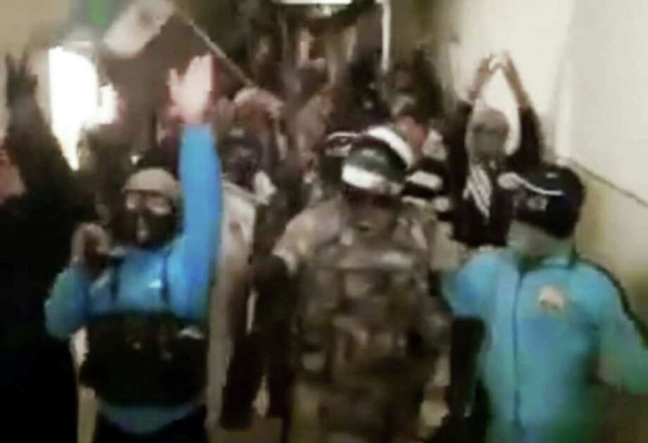 In this image made from amateur video and released by Ugarit News Wednesday, March 21, 2012, purports to show Syrian rebels chanting slogans in in Deir Al Zor 450 Kilometers (280 miles) northeast of Damascus, Syria. The Syrian uprising, which began one year ago, is transforming into an armed insurgency that many fear is pushing the country toward civil war. Because of Syria's close alliances with Iran and the Lebanese militant group Hezbollah, there are deep concerns that the violence could spread beyond the country's borders, especially if other nations arm the rebels or send in their own troops. (AP Photo/Ugarit News via APTN) THE ASSOCIATED PRESS CANNOT INDEPENDENTLY VERIFY THE CONTENT, DATE, LOCATION OR AUTHENTICITY OF THIS MATERIAL. TV OUT Photo: Anonymous   / Ugarit News