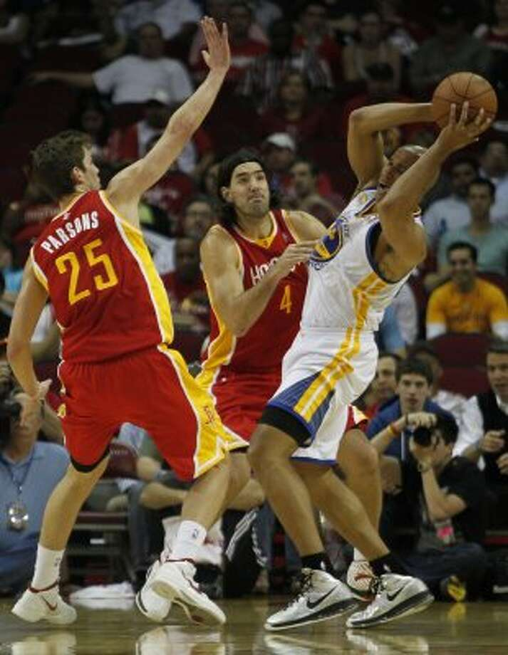 March 22: Rockets 109, Clippers 83 Rockets' Chandler Parsons left and Luis Scola center, double-team the Golden State Warriors' Richard Jefferson. (James Nielsen / Chronicle)