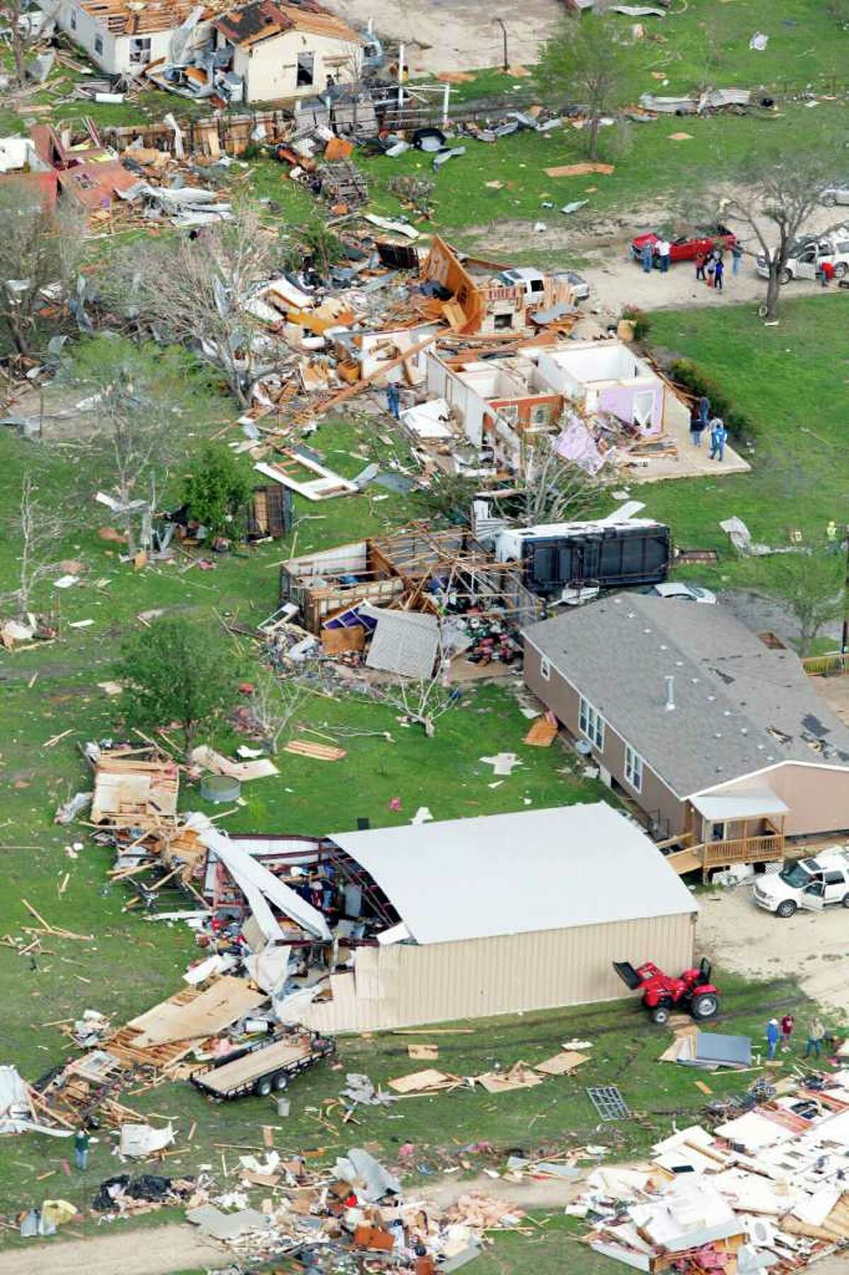 Damage from an overnight tornado in the Devine area is seen in this Tuesday March 20, 2012 aerial image.