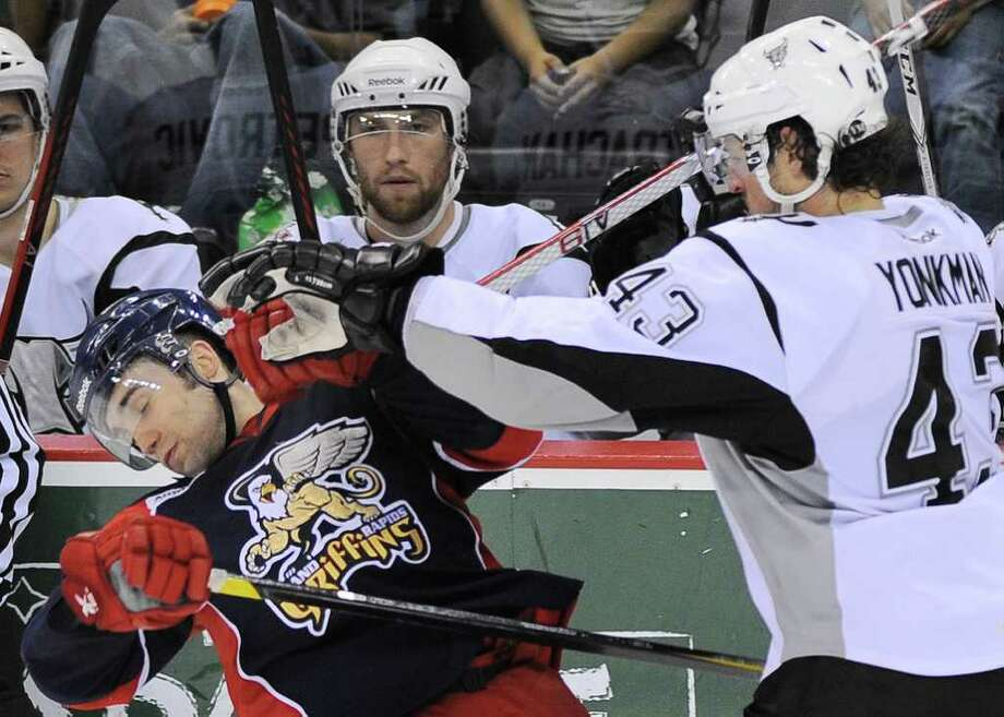 San Antonio Rampage's Nolan Yonkman, right, checks Grand Rapids Griffins' Chris Conner during the third period of an AHL hockey game, Thursday, March 22, 2012, in San Antonio. San Antonio won 4-2. Photo: Darren Abate, Darren Abate/pressphotointl.com / Darren Abate/pressphotointl.com