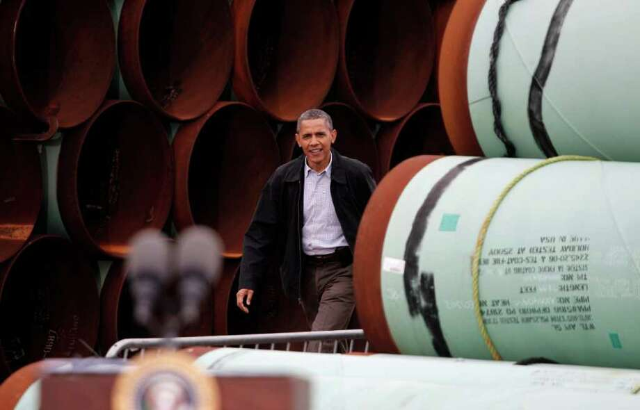 President Barack Obama arrives to speaks at the TransCanada Pipe Yard in Cushing, Okla., Thursday, March 22, 2012. (AP Photo/LM Otero) Photo: LM Otero
