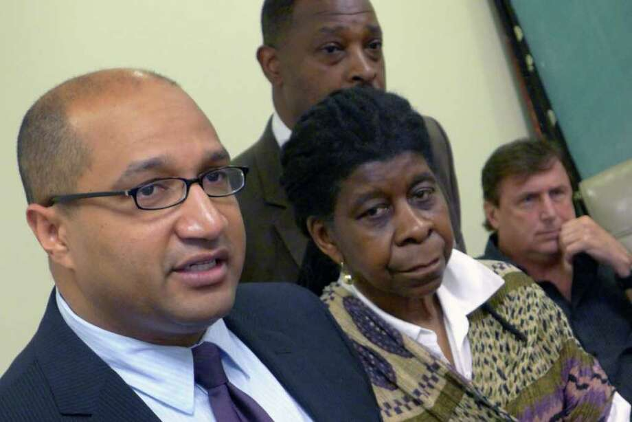 Albany County District Attorney David Soares, left, was joined by civil rights activist Alice Green, center, and Pastor Charlie Muller, right, Thursday afternoon March 22, 2012 in Albnay, N.Y., to announce that a grand jury had determined use of deadly physical force was justified in the shooting of Nah-Cream Moore by an Albany police officer last Dec. (Michael P. Farrell/Times Union) Photo: Michael P. Farrell