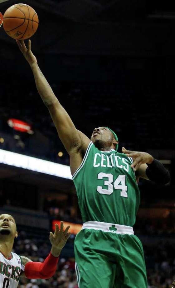 Boston Celtics' Paul Pierce (34) drives against Milwaukee Bucks' Drew Gooden, left, during the first half of an NBA basketball game on Thursday, March 22, 2012, in Milwaukee. (AP Photo/Jeffrey Phelps) Photo: JEFFREY PHELPS