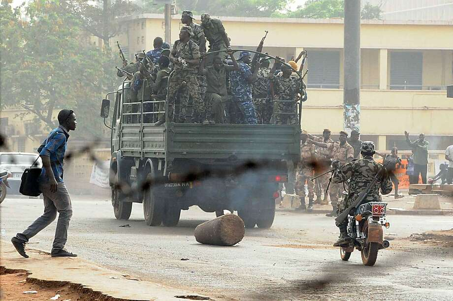 """Soldiers crowd a truck in a street of Bamako on March 22, 2012. Malian President Amadou Toumani Toure, who was forced to flee his palace during an overnight coup, is well and in a safe location, a loyalist military source told AFP Thursday.  Toure, who was to step down after an election scheduled for April 29, is """"in good health... and in a safe location"""" following the seizure of power by a group of renegade soldiers, the official said without elaborating. Photo: Habibou Kouyate, AFP/Getty Images"""