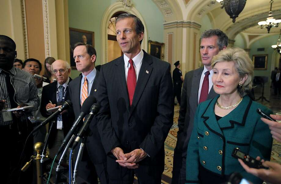 Sen. John Thune, R-S.D., speaks during a news conference on Capitol Hill in Washington, Thursday, March 22, 2012, after the Senate voted on the JOBS act. From left are, Sen. Pat Toomey, R-Pa., Thune, Sen. Scott Brown, R-Mass., and Sen. Kay Bailey Hutchison. Photo: Charles Dharapak, Associated Press