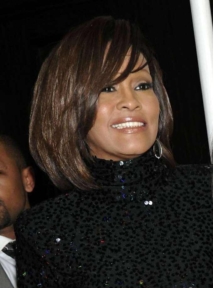 In this Feb. 12, 2011 file photo, singer Whitney Houston, left, and her daughter Bobbi Kristina arrive at the Pre-Grammy Gala & Salute to Industry Icons with Clive Davis honoring David Geffen in Beverly Hills, Calif. Coroner's officials said Thursday, March 22, 2012, that Houston drowned, but her death was also caused by heart disease and cocaine use that suggested she was chronically using the drug. Houston died Feb. 11, in California at the age of 48. Photo: Dan Steinberg, Associated Press