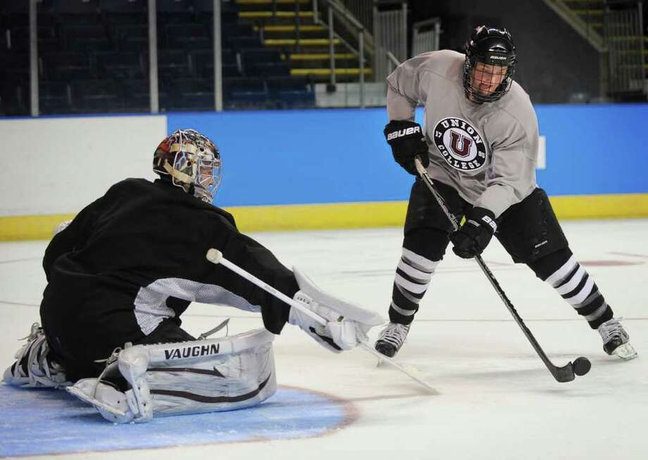 Union College's Daniel Carr skates in on goalie Troy Grosenik during practice at the NCAA Tournament East Regional in Bridgeport, Conn. on Thursday, March 22, 2012. Photo: Brian A. Pounds / Connecticut Post