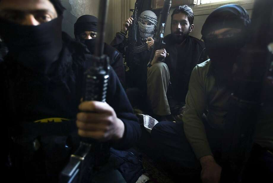 Members of the rebel 'Free Syrian Army' gather inside their quarters in the Syrian town of Binnish (Binesh), in the restive northern Idlib province, on March 22, 2012. For days now, the people in this northwestern town of 30,000 not far from the Turkish border have been expecting the worst, as nearby villages are besieged by tanks, then attacked and captured. Photo: Ricardo Garcia Vilanova, AFP/Getty Images