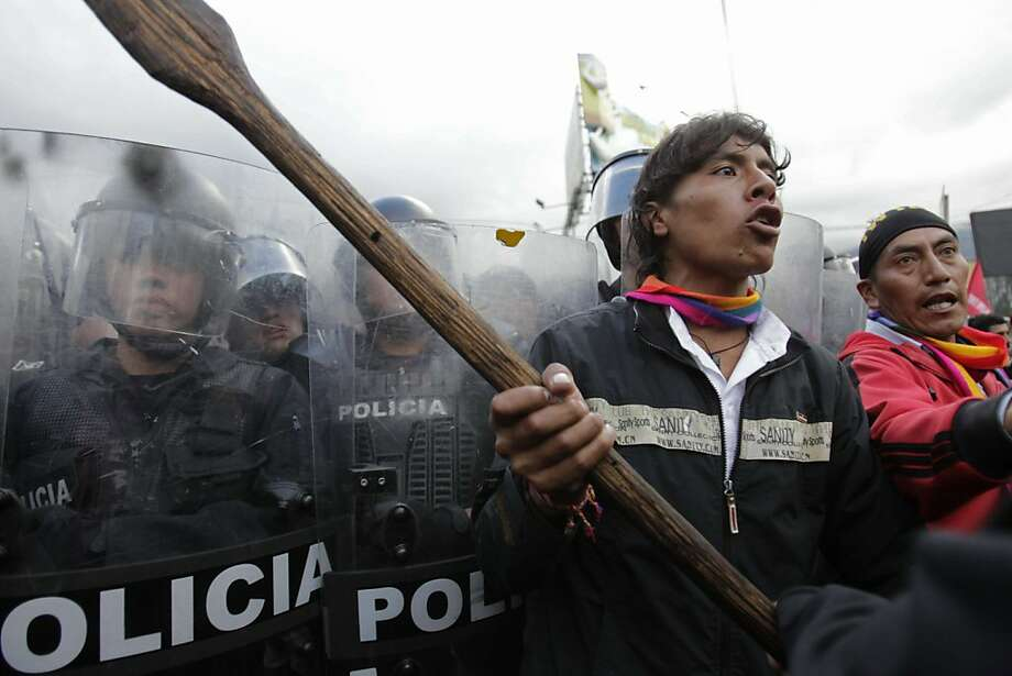 Protesters clash with police as they try to enter the National Assembly in Quito, Ecuador, Thursday March 22, 2012. Protesters reached Ecuador's capital on Thursday after a two-week march from the Amazon to oppose plans for large-scaling mining projects on their lands. (AP Photo/Dolores Ochoa) Photo: Dolores Ochoa, Associated Press