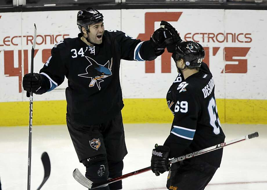 San Jose Sharks left wing Daniel Winnik (34) is congratulated by Andrew Desjardins (69) after scoring past the Boston Bruins in the third period of an NHL hockey game in San Jose, Calif., Thursday, March 22, 2012. Photo: Paul Sakuma, Associated Press