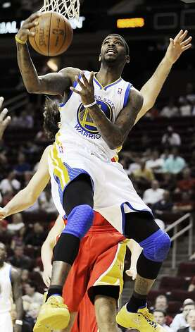 Golden State Warriors' Dorell Wright shoots against the Houston Rockets in the first half of an NBA basketball game, Thursday, March 22, 2012, in Houston. Photo: Pat Sullivan, Associated Press