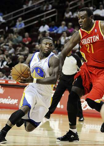 Golden State Warriors' Nate Robinson (2) drives around Houston Rockets' Samuel Dalembert (21) in the first half of an NBA basketball game, Thursday, March 22, 2012, in Houston. Photo: Pat Sullivan, Associated Press