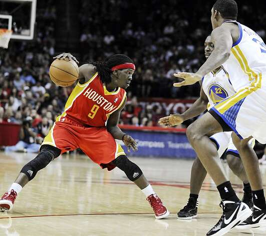 Houston Rockets' Courtney Fortson (9) looks for room against Golden State Warriors' Charles Jenkins (22) and Chris Wright (33) in the second half of an NBA basketball game, Thursday, March 22, 2012, in Houston. The Rockets won 109-83. Photo: Pat Sullivan, Associated Press