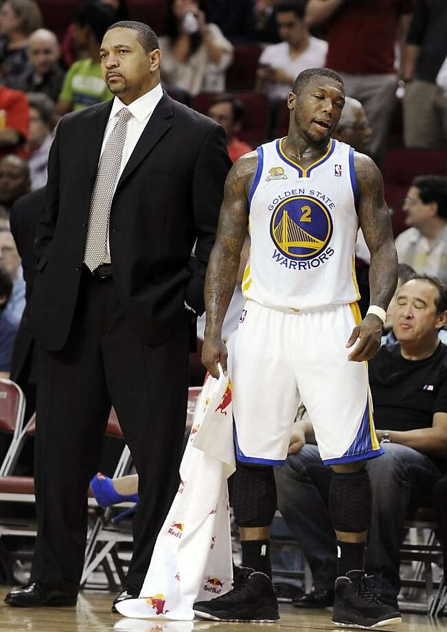 Golden State Warriors' Nate Robinson (2) and coach Mark Jackson reacts to Robinson receiving a flagrant foul call against the Houston Rockets in the second half of an NBA basketball game, Thursday, March 22, 2012, in Houston. The Rockets won 109-83. (AP Photo/Pat Sullivan) Photo: Pat Sullivan, Associated Press