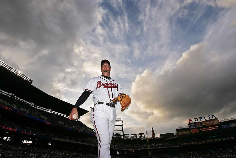 In this photo taken, May 18, 2008, Atlanta Braves third baseman Chipper Jones walks off the field before the Braves faced off against the Oakland Athletics in a baseball game at Turner Field in Atlanta. Jones says this will be his final season. Jones, who turns 40 next month, issued a statement through the team Thursday, March 22, 2012, saying he will retire after the season. (AP Photo/Atlanta Journal-Constitution, Pouya Dianat) Photo: Pouya Dianat, Associated Press