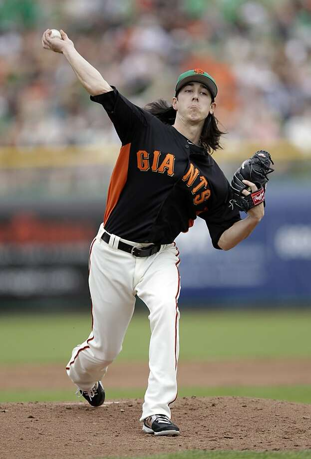 San Francisco Giants starting pitcher Tim Lincecum throws to the Oakland Athletics during the first inning of a spring training baseball game Saturday, March 17, 2012 in Scottsdale, Ariz. (AP Photo/Marcio Jose Sanchez) Photo: Marcio Jose Sanchez, Associated Press