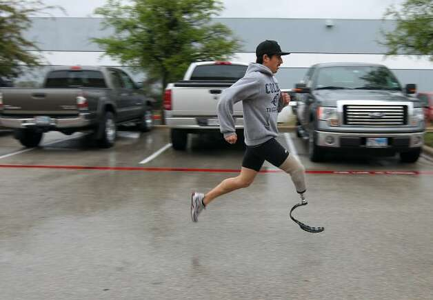 Paralympic Games hopeful James Ortiz tests out his new running prosthetic at Orthotic and Prosthetic Technologies in Round Rock on Friday, Mar. 9, 2012. Ortiz, 27, lost his leg in an accident in 2006. But with the help of OPT, Ortiz is trying to qualify for a chance to compete in the Paralympic Games in London. (Kin Man Hui / San Antonio Express-News)