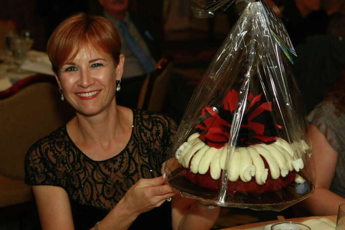 Petra Tabor holding cake she won in the Dessert Auction at the Crossroads School Gala,