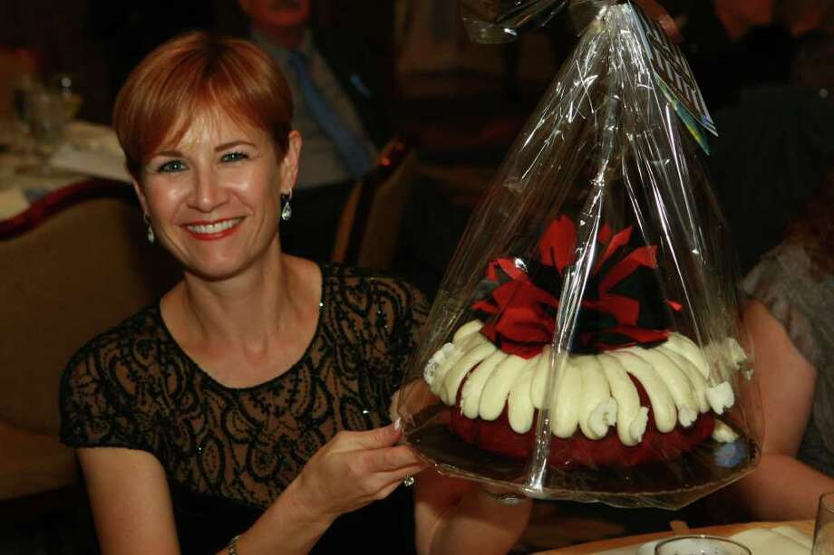 "Petra Tabor holding cake she won in the Dessert Auction at the Crossroads School Gala, ""A Golden Evening"" Photo: Keith Brook"
