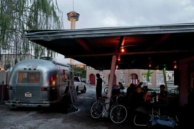 taste - Chris Cullum's Attaboy Burgers Land Yacht is one of three food trucks serving food at Alamo Street Eat Bar on Tuesday, March 20, 2012. LISA KRANTZ/San Antonio Express-News Photo: Lisa Krantz, San Antonio Express-News / @San Antonio Express-News
