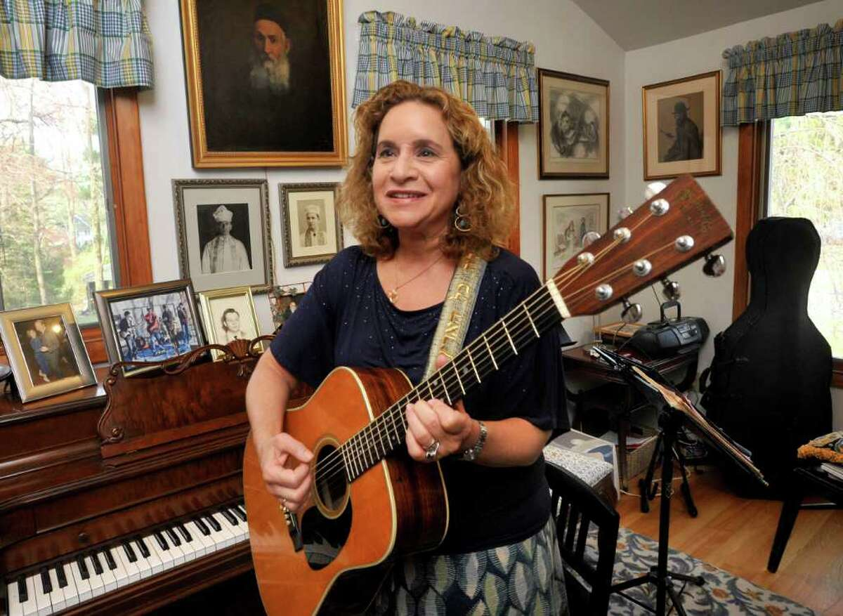 Cantor Deborah Katchko-Gray plays Passover seder songs in her Ridgefield home Friday, March 23, 2012.
