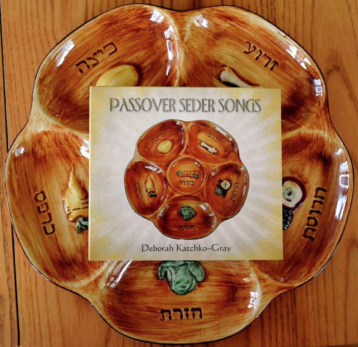 Cantor Deborah Katchko-Gray's CD of Passover seder songs rests on a seder plate in her Ridgefield home Friday, March 23, 2012.