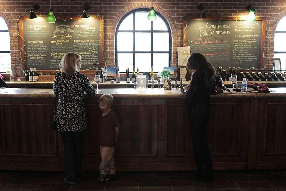 Gina Donofrio (L-R), Anthony, 5, and Gina Zarzana-Stiriti, purchase wines at Concannon tasting room in Livermore, California on March 15, 2012. Photo: Pete Kiehart, The Chronicle