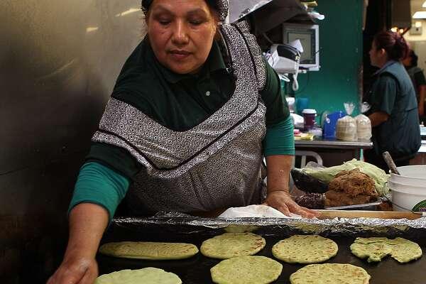 Maria Barrentos making cactus corn handmade tortillas at La Palma Mexica-tessen in San Francisco, California, on Tuesday, September 6, 2011.  She's been making tortillas for La Palma for 20 years.