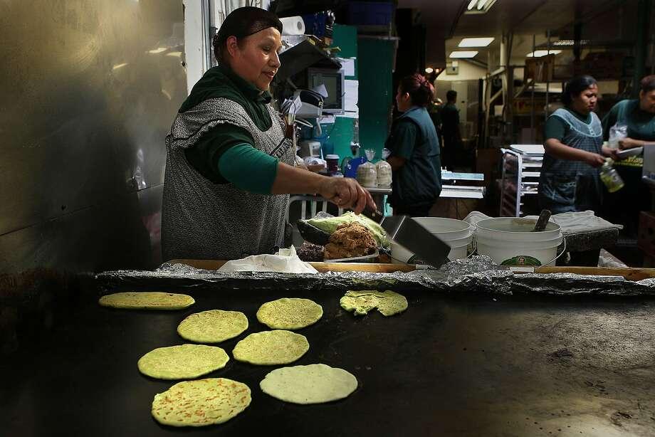Maria Barrentos making cactus corn handmade tortillas at La Palma Mexica-tessen in San Francisco, California, on Tuesday, September 6, 2011.  She's been making tortillas for La Palma for 20 years. Photo: Liz Hafalia, The Chronicle