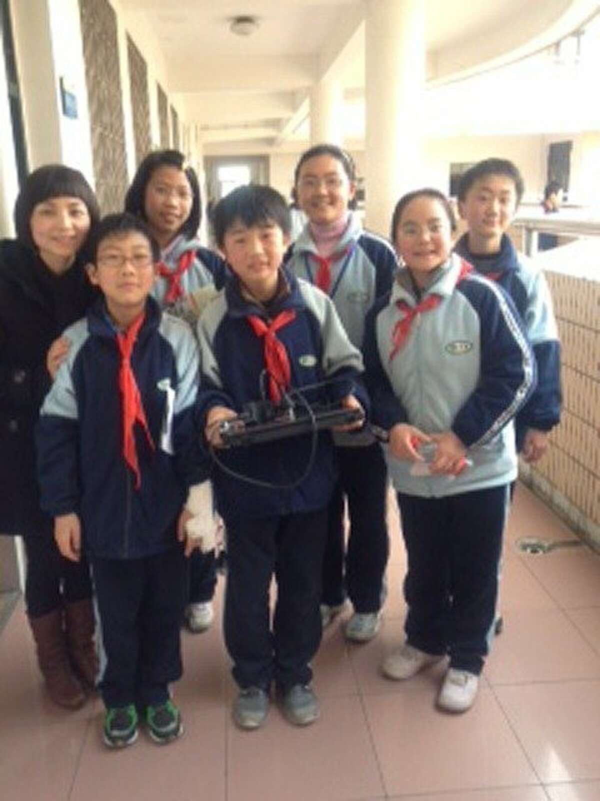 """The seventh-grade class at Wenlai Middle School, Shanghai, China. Alexander Oliver (center) holds something he would like to """"crack open""""."""