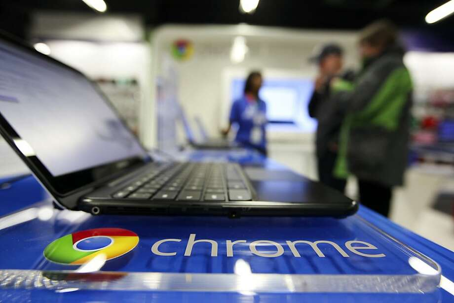 An employee demonstrates a Samsung Electronics Co. Chromebook laptop to customers in the Google Inc. sales area at a Currys and PC World 2 in 1 store, operated by Dixons Retail Plc, on Tottenham Court Road in London, U.K., on Wednesday, Dec. 7, 2011. U.K. shop-price inflation slowed in November to the lowest in a year as a supermarket price war curbed food-cost increases, the British Retail Consortium said. Photographer: Chris Ratcliffe/Bloomberg Photo: Chris Ratcliffe, Bloomberg News