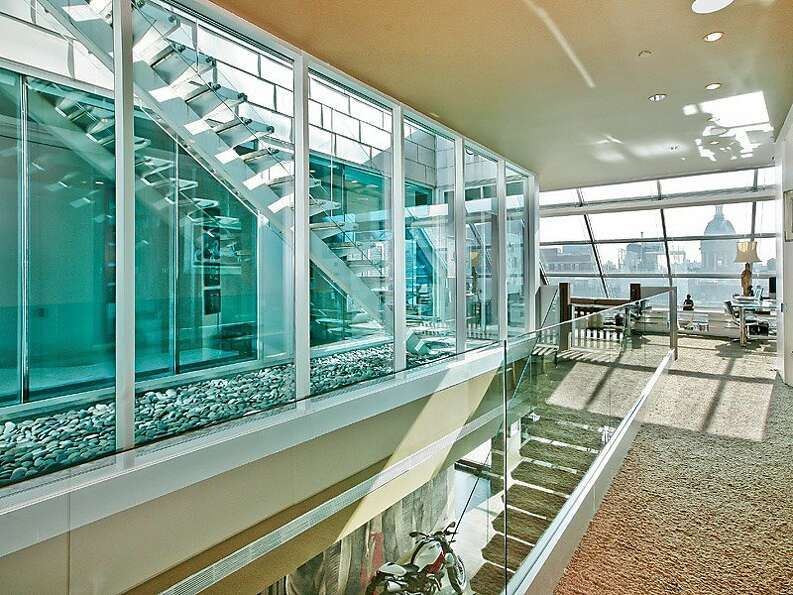 Take the floating glass staircase to the second floor, which features carpet flooring and provides p