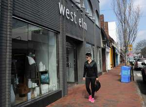 Shoppers walk near West Elm, a store that opened in Nov. 2011 at 37 Main Street in Westport, Conn. on Thursday, March 22, 2012. There have been many changes to retail offerings on Main Street in Westport, Conn.