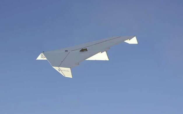 "The 800-pound paper airplane takes flight after being released from a helicopter during the Pima Air & Space Museum's ""Great Paper Airplane Project,"" on March 21, 2012 outside of Tucson, Ariz. Photo: BALFOUR_WALKER, Balfour Walker Photography / (c)BALFOURWALKER.COM"