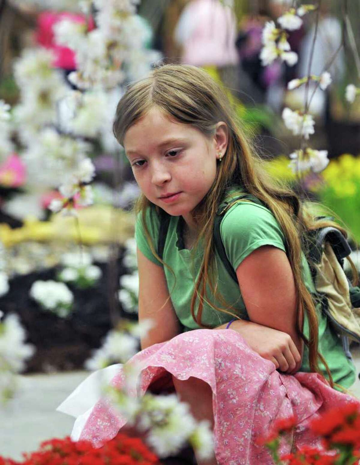 Nine-year-old Flavia Muller of Stephentown studies a display at the 25th Capital District Garden and Flower Show at Hudson Valley Community College in Troy on Friday, March 23, 2012. (John Carl D'Annibale / Times Union)