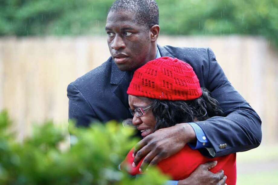 Ron Tata hugs his sister Jessica Tata, 22, operator of the day care facility called Jackie's Child Care, after a fire broke out at the day care center leaving four children dead Thursday, Feb. 24, 2011, in Houston. Photo: Michael Paulsen, Houston Chronicle / Houston Chronicle