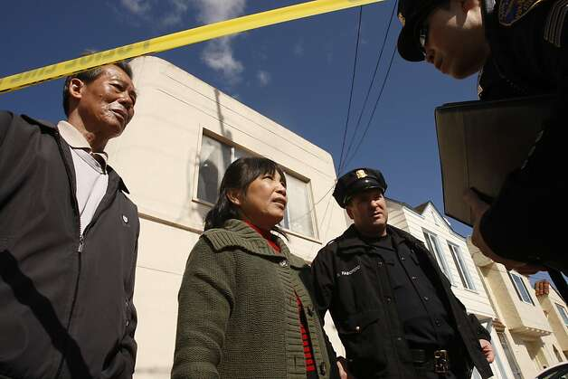 Neighbors Huang Ruixu (left) and Chan-Fong Lin speak to investigators outside the crime scene on Howth Street. Photo: Siana Hristova, The Chronicle