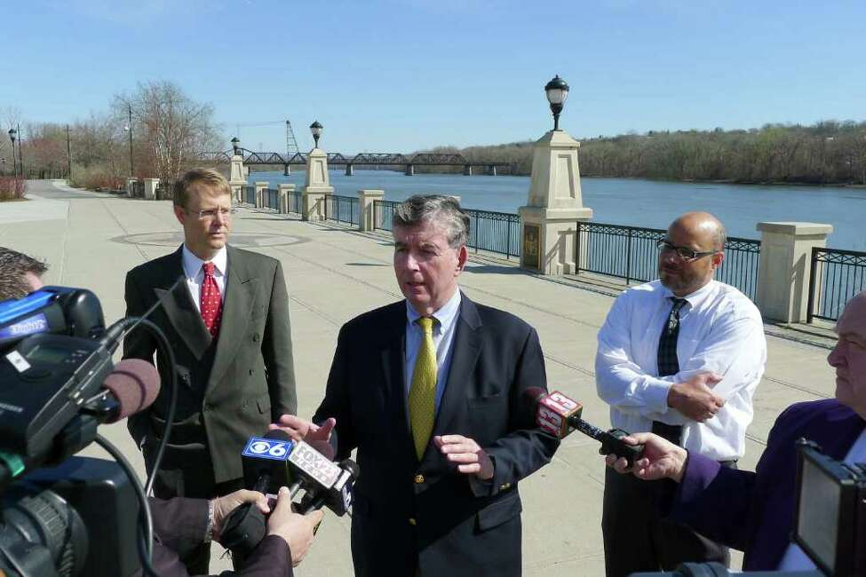 David VanLuven, director of Enviroment New York, state Sen. Neil Breslin and Jeff Rumpf, executive director of Clearwater, hold a press conference to announce findings of a new report showing the Hudson, Seneca and Genesee rivers remain amoung the most polluted in America in Albany N.Y., Friday March 23, 2012. (Michael P. Farrell/Times Union)
