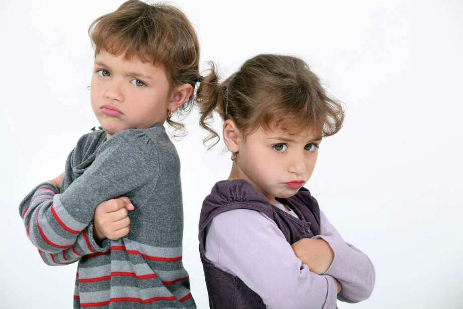 Do parents really favor one sibling over another? (Fotolia.com) / auremar - Fotolia