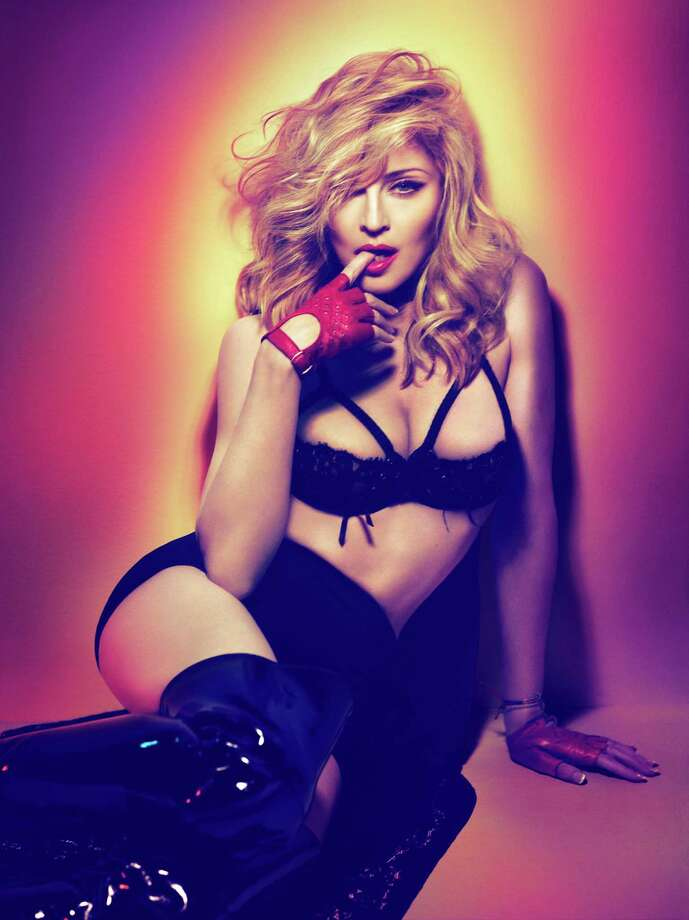 Madonna delves into deep, dark dance beats on MDNA. It's in stores March 26. Photo by Mert + Marcus. Photo: Photo By Mert + Marcus