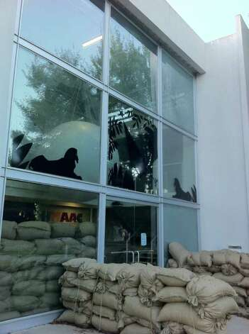 "Sandbags at the entrance to the Houston Museum of African American Culture (HMAAC) are part of ""Fort HMAAC,"" an installation by the art collective Otabenga Jones & Associates. Photo: Molly Glentzer"