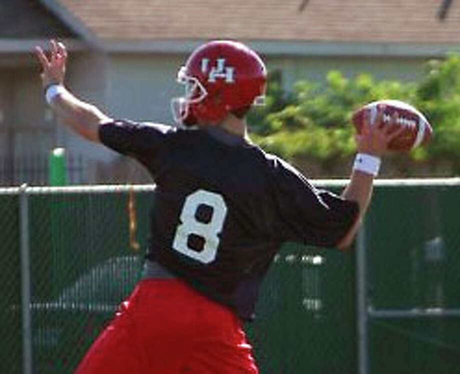 Quarterback David Piland showed a command and playmaking ability that gives the Cougars hope heading into 2012. Photo: Sam Khan Jr./Chronicle